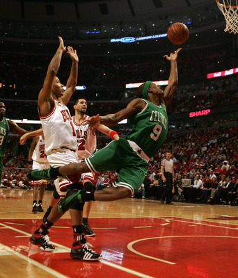 CHICAGO - APRIL 30: Rajon Rondo #9 of the Boston Celtics puts up a shot past Derrick Rose #1 and Brad Miller #52 of the Chicago Bulls in Game Six of the Eastern Conference Quarterfinals during the 2009 NBA Playoffs at the United Center on April 30, 2009 i