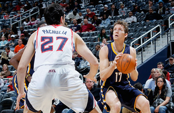ATLANTA, GA - DECEMBER 11:  Mike Dunleavy #17 of the Indiana Pacers against Zaza Pachulia #27 of the Atlanta Hawks at Philips Arena on December 11, 2010 in Atlanta, Georgia.  NOTE TO USER: User expressly acknowledges and agrees that, by downloading and/or