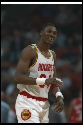 14 Jun 1995:  Center Hakeen Olajuwon of the Houston Rockets celebrates during a Finals game against the Orlando Magic at The Summit in Houston, Texas.  The Rockets won the game, 113-101. Mandatory Credit: ALLSPORT USA  /Allsport Mandatory Credit: ALLSPORT