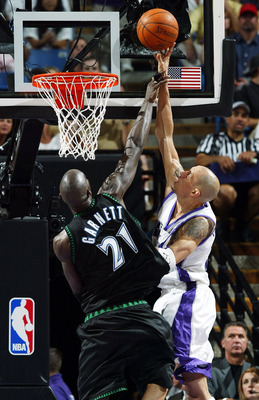 SACRAMENTO, CA - MAY 16:  Kevin Garnett #21 of the Minnesota Timberwolves defends against Doug Christie #13 of the Sacramento Kings during Game six of the Western Conference Semifinals of the 2004 NBA Playoffs at Arco Arena on May 16, 2004 in Sacramento,