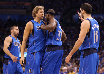 OKLAHOMA CITY, OK - MAY 21:  (L-R) Jose Juan Barea #11, Dirk Nowitzki #41, Brendan Haywood #33, and Peja Stojakovic #16 of the Dallas Mavericks celebrate in the second quarter while taking on the Oklahoma City Thunder in Game Three of the Western Conferen