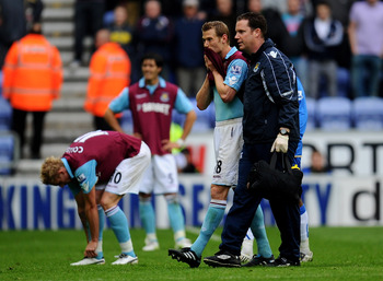 WIGAN, ENGLAND - MAY 15:  Jonathan Spector of West Ham United looks dejected following his team's relegation at the end of the Barclays Premier League match between Wigan Athletic and West Ham United at the DW Stadium on May 15, 2011 in Wigan, England.  (
