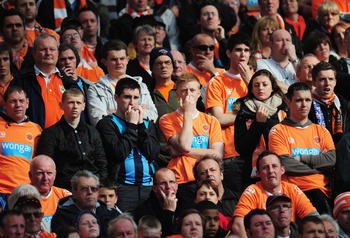 MANCHESTER, ENGLAND - MAY 22:  Blackpool fans look dejected during the Barclays Premier League match between Manchester United and Blackpool at Old Trafford on May 22, 2011 in Manchester, England.  (Photo by Shaun Botterill/Getty Images)