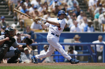 LOS ANGELES - JULY 22:  Shawn Green of the Los Angeles Dodgers bats against the Colorado Rockies on July 22, 2004 at Dodger Stadium in Los Angeles, California.  The Dodgers defeated the Rockies 4-2.  (Photo by Lisa Blumenfeld/Getty Images)