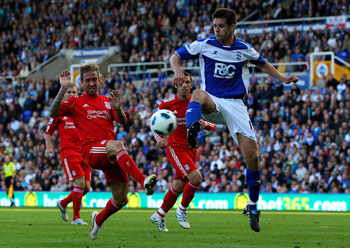 BIRMINGHAM, ENGLAND - SEPTEMBER 12:  Raul Meireles of Liverpool challenges Scott Dann of Birmingham City during the Barclays Premier League match between Birmingham City and Liverpool at St Andrew's Stadium on September 12, 2010 in Birmingham, England. (P
