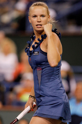 INDIAN WELLS, CA - MARCH 18: Caroline Wozniacki of Denmark celebrates match point against Maria Sharapova of Russia during the semifinals of the BNP Paribas Open at the Indian Wells Tennis Garden on March 18, 2011 in Indian Wells, California.  (Photo by M