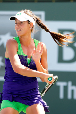 INDIAN WELLS, CA - MARCH 13:  Ana Ivanovic of Serbia returns a shot to Barbora Zahlavova Strycova of the Czech Republic during the BNP Paribas Open at the Indian Wells Tennis Garden on March 13, 2011 in Indian Wells, California.  (Photo by Matthew Stockma