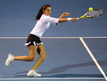 HOBART, AUSTRALIA - JANUARY 14:  Sania Mirza of India returns a shot to Edina Gallovitis of Romania and Arantxa Parra Santonja of Spain during their double match on day six of the Moorilla Hobart International at the Domain Tennis Centre on January 14, 20