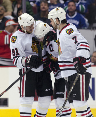 VANCOUVER, CANADA - APRIL 26: Jonathan Toews #19 of the Chicago Blackhawks is congratulated by Marian Hossa #81 and Brent Seabrook #7 after scoring the game tying goal during the third period in Game Seven of the Western Conference Quarterfinals during th