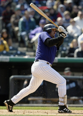 DENVER - APRIL 6:  Right fielder Larry Walker #33 of the Colorado Rockies puts the ball in play during the game against the Arizona Diamondbacks at Coors Field on April 6, 2003 in Denver, Colorado.  The Rockies defeated the Diamondbacks 8-3.  (Photo by Br
