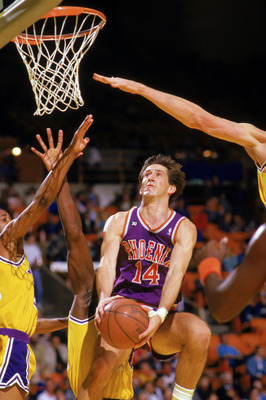 INGLEWOOD, CA - 1988:  Jeff Hornacek #14 of the Phoenix Suns shoots against the Los Angeles Lakers during the game at the Great Western Forum in Inglewood, California. (Photo by Mike Powell/Getty Images)