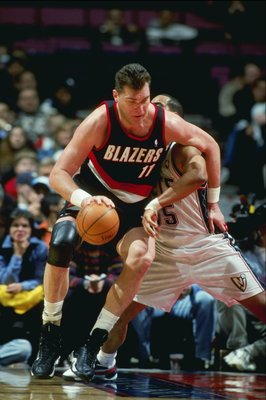 24 Feb 1999:  Arvydas Sabonis #11 of the Portland Trailblazers dribbles the ball during the game against the New Jersey Nets at the Continental Airlines Arena in East Rutherford, New Jersey. The Trailblazers defeated the Nets 94-85.  Mandatory Credit: Al