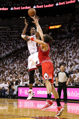MIAMI, FL - MAY 22:  Chris Bosh #1 of the Miami Heat attempts a shot agaist Joakim Noah #13 of the Chicago Bulls in Game Three of the Eastern Conference Finals during the 2011 NBA Playoffs on May 22, 2011 at American Airlines Arena in Miami, Florida.  NOT
