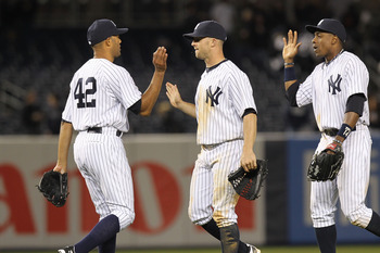 NEW YORK, NY - APRIL 02:  Mariano Rivera #42 of the New York Yankees celebrates the win with teammates Brett Gardner #11 and Curtis Granderson #14  against the Detroit Tigers at Yankee Stadium on April 2, 2011 in the Bronx borough of New York City.  (Phot