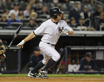 NEW YORK, NY - MAY 13:  Brett Gardner #11 of the New York Yankees gets a hits against the Boston Red Sox during their game on May 13, 2011 at Yankee Stadium in the Bronx borough of New York City.  (Photo by Al Bello/Getty Images)
