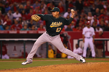 ANAHEIM, CA - MAY 23:  Brian Fuentes #57 of the Oakland Athletics pitches against the Los Angeles Angeles of Anaheim in the eighth inning at Angel Stadium on May 23, 2011 in Anaheim, California.  (Photo by Joe Scarnici/Getty Images)