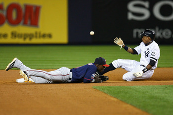 NEW YORK - OCTOBER 09:  Curtis Granderson #14 of the New York Yankees safely steals second base against Orlando Hudson #1 of the Minnesota Twins during the bottom of the fourth inning of Game Three of the ALDS part of the 2010 MLB Playoffs at Yankee Stadi