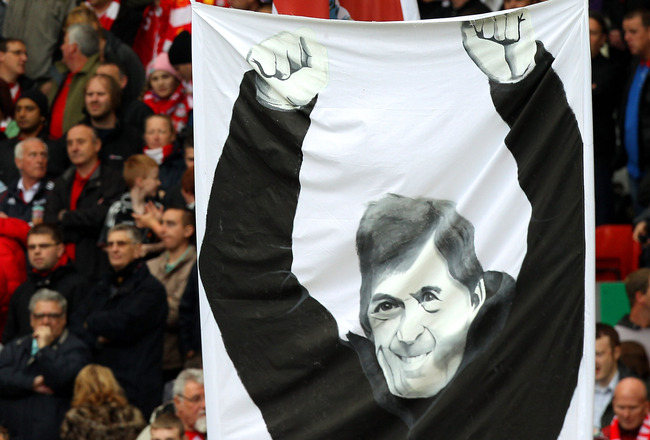 LIVERPOOL, ENGLAND - MAY 15:  Liverpool fans display banners dedicated to former player and now manager, Kenny Dalglish during the Barclays Premier League match between Liverpool and Tottenham Hotspur at Anfield on May 15, 2011 in Liverpool, England.  (Ph