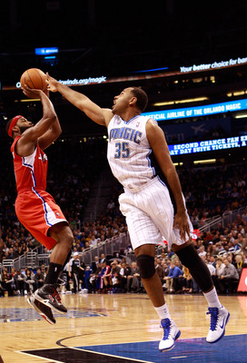 ORLANDO, FL - FEBRUARY 08:  Baron Davis #5 of the Los Angeles Clippers attempts a shot against Malik Allen #35 of the Orlando Magic during the game at Amway Arena on February 8, 2011 in Orlando, Florida.  NOTE TO USER: User expressly acknowledges and agre