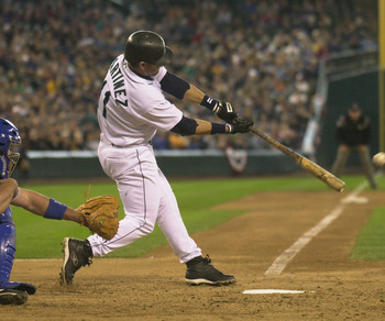 SEATTLE - APRIL 13:  Designated hitter Edgar Martinez #11 of the Seattle Mariners makes contact with the ball during the game against the Texas Rangers at Safeco Field on April 13, 2003 in Seattle Washington.  The Mariners defeated the Rangers 4-3 in extr