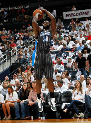 ATLANTA, GA - APRIL 24:  Brandon Bass #30 of the Orlando Magic against the Atlanta Hawks during Game Four of the Eastern Conference Quarterfinals in the 2011 NBA Playoffs at Philips Arena on April 24, 2011 in Atlanta, Georgia.  NOTE TO USER: User expressl