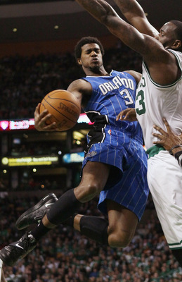 BOSTON, MA - FEBRUARY 06:  Earl Clark #3 of the Orlando Magic tries to get around Kendrick Perkins #43 of the Boston Celtics on February 6, 2011 at the TD Garden in Boston, Massachusetts. The Celtics defeated the Magic 91-80. NOTE TO USER: User expressly