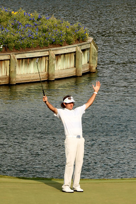 PONTE VEDRA BEACH, FL - MAY 13:  Bubba Watson celebrates chipping in for birdie on the 17th hole during the second round of THE PLAYERS Championship held at THE PLAYERS Stadium course at TPC Sawgrass on May 13, 2011 in Ponte Vedra Beach, Florida.  (Photo