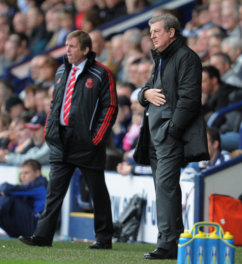 WEST BROMWICH, ENGLAND - APRIL 02:  Liverpool manager Kenny Dalglish and West Brom manager Roy Hodgson look on during the Barclays Premier League match between West Bromwich Albion and Liverpool at The Hawthorns on April 2, 2011 in West Bromwich, England.