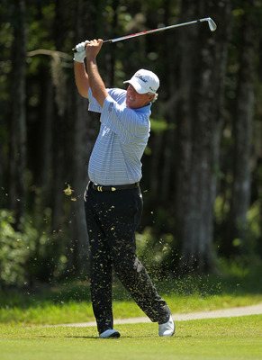 LUTZ, FL - APRIL 17:  Russ Cochran hits his approach shot on the 12th hole during the final round of the Outback Steakhouse Pro-Am at the TPC of Tampa on April 17, 2011 in Lutz, Florida.  (Photo by Mike Ehrmann/Getty Images)