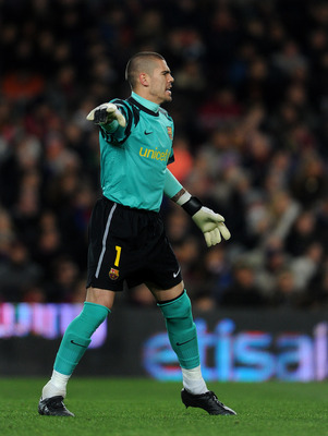 BARCELONA, SPAIN - JANUARY 22:  Goalkeeper Victor Valdes of Barcelona reacts during the la liga match between Barcelona and Racing Santander at the Camp Nou stadium on January 22, 2011 in Barcelona, Spain.  (Photo by Jasper Juinen/Getty Images)