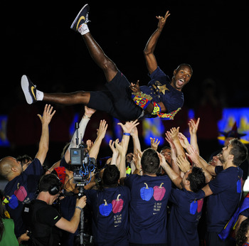 BARCELONA, SPAIN - MAY 13:  Eric Abidal of FC Barcelona is lifted by his team-mates during the celebrations for winning the Spanish Liga at the Camp Nou Stadium on May 13, 2011 in Barcelona, Spain.  (Photo by David Ramos/Getty Images)