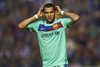 VALENCIA, SPAIN - MAY 11:  Daniel Alves of Barcelona reacts during the La Liga match between Levante UD and Barcelona at Ciutat de Valencia on May 11, 2011 in Valencia, Spain. The match ended 1-1.  (Photo by Manuel Queimadelos Alonso/Getty Images)