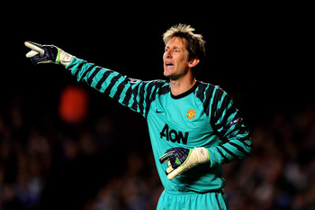 LONDON, ENGLAND - APRIL 06:  Goalkeeper Edwin Van Der Sar of Manchester United gestures during the UEFA Champions League quarter final first leg match between Chelsea and Manchester United at Stamford Bridge on April 6, 2011 in London, England.  (Photo by