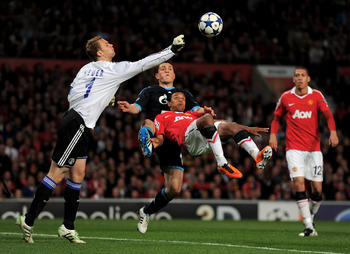 MANCHESTER, ENGLAND - MAY 04:  Manuel Neuer of Schalke punches clear under pressure from Nani of Manchester United during the UEFA Champions League Semi Final second leg match between Manchester United and Schalke at Old Trafford on May 4, 2011 in Manches