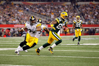 ARLINGTON, TX - FEBRUARY 06:  James Jones #89 of the Green Bay Packers runs for yards after the catch against James Harrison #92 of the Pittsburgh Steelers during Super Bowl XLV at Cowboys Stadium on February 6, 2011 in Arlington, Texas. The Packers won 3