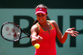 PARIS, FRANCE - MAY 24:  Ana Ivanovic of Serbia plays a forehand during the women's singles round one match between Johanna Larsson of Sweden and Ana Ivanovic of Serbia on day three of the French Open at Roland Garros on May 24, 2011 in Paris, France.  (P