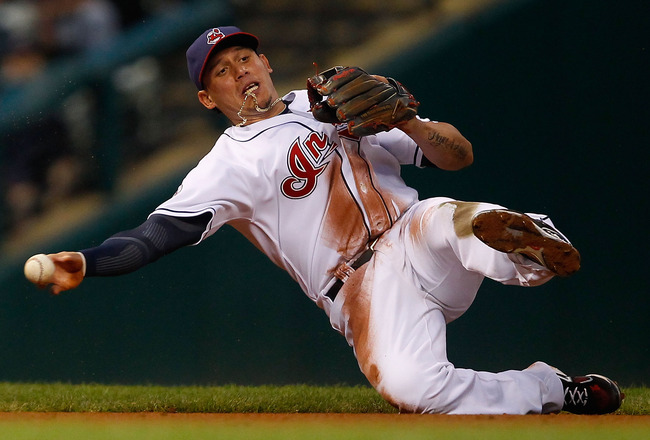 CLEVELAND - MAY 13:  Asdrubal Cabrera #13 of the Cleveland Indians fields a ground ball against the Seattle Mariners during the game on May 13, 2011 at Progressive Field in Cleveland, Ohio.  (Photo by Jared Wickerham/Getty Images)