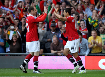 MANCHESTER, ENGLAND - MAY 08:  Javier Hernandez of Manchester United celebrates scoring the opening goal with team mate Wayne Rooney (L) during the Barclays Premier League match between Manchester United and Chelsea at Old Trafford on May 8, 2011 in Manch