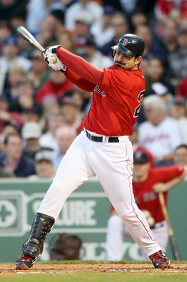 BOSTON, MA - MAY 20:  Adrian Gonzalez #28 of the Boston Red Sox gets a hits a in the first inning against the Chicago Cubs on May 20, 2011 at Fenway Park in Boston, Massachusetts.on May 20, 2011 at Fenway Park in Boston, Massachusetts. The Chicago Cubs an