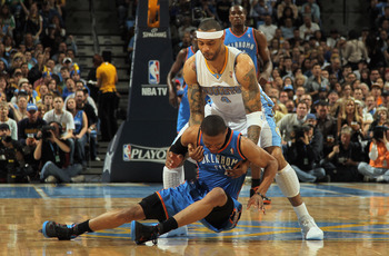 DENVER, CO - APRIL 25:  Kenyon Martin #4 of the Denver Nuggets catches Russell Westbrook #0 of the Oklahoma City Thunder as he falls to the court in Game Four of the Western Conference Quarterfinals in the 2011 NBA Playoffs on April 24, 2011 at the Pepsi
