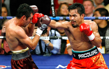 LAS VEGAS - DECEMBER 06:  Manny Pacquiao (R) hits Oscar De La Hoya in the fifth round of their welterweight bout at the MGM Grand Garden Arena December 6, 2008 in Las Vegas, Nevada.  (Photo by Ethan Miller/Getty Images)