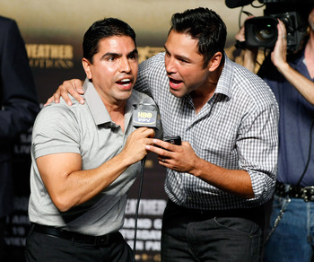 LAS VEGAS - SEPTEMBER 18:  Radio personality Eddie 'Piolin' Sotelo (L) and boxing promoter Oscar De La Hoya entertain the crowd during the official weigh-in for boxers Floyd Mayweather Jr. and Juan Manuel Marquez at the MGM Grand Garden Arena September 18