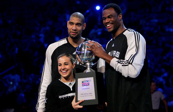 NEW ORLEANS - FEBRUARY 16:  Tim Duncan of the San Antonio Spurs, NBA legend David Robinson and WNBA player Becky Hammon of the San Antonio Silver Star pose with the championship trophy after winning the Haier Shooting Stars competition, part of 2008 NBA A