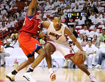 MIAMI, FL - APRIL 18:  Juwan Howard #5 of the Miami Heat drives around Thaddeus Young #21 of the Philadelphia 76ers during game two of the Eastern Conference Quarterfinals at American Airlines Arena on April 18, 2011 in Miami, Florida. NOTE TO USER: User
