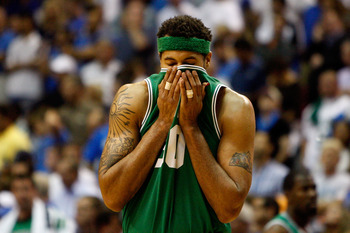 ORLANDO, FL - MAY 26:  Rasheed Walalce #30 of the Boston Celtics wipes his face with his jersey against the Orlando Magic in Game Five of the Eastern Conference Finals during the 2010 NBA Playoffs at Amway Arena on May 26, 2010 in Orlando, Florida.  NOTE