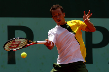 PARIS, FRANCE - MAY 24:  Philipp Kohlschreiber of Germany plays a forehand during the men's singles round one match between Sam Querrey of USA and Philipp Kohlschreiber of Germany on day three of the French Open at Roland Garros on May 24, 2011 in Paris, 