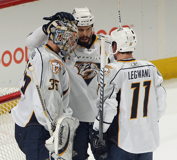 DENVER, CO - MARCH 31:  Goalie Pekka Rinne #35 of the Nashville Predators is congratulated by teammates Shea Weber #6 and David Legwand #11 after their victory over the Colorado Avalanche at the Pepsi Center on March 31, 2011 in Denver, Colorado. Rinne ha
