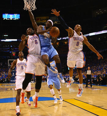 OKLAHOMA CITY, OK - APRIL 20: Ty Lawson #3 of the Denver Nuggets drives to the basket against Kendrick Perkins #5 and Russell Westbrook #0 both of the Oklahoma City Thunder in Game Two of the Western Conference Quarterfinals in the 2011 NBA Playoffs on Ap