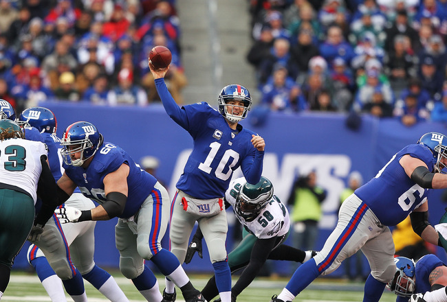 EAST RUTHERFORD, NJ - DECEMBER 19:  Eli Manning #10 of the New York Giants throws the ball during their game against the Philadelphia Eagles on December 19, 2010 at The New Meadowlands Stadium in East Rutherford, New Jersey.  (Photo by Al Bello/Getty Imag