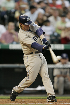 DENVER - JULY 27:  Khalil Greene #3 of the San Diego Padres bats against the Colorado Rockies at Coors Field on July 27, 2006 in Denver, Colorado. The Rockies defeated the Padres 9-8.  (Photo by Brian Bahr/Getty Images)